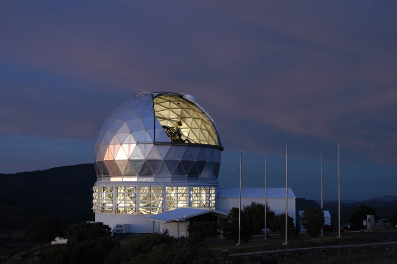 With the dome open, astronomers prepare HET for another night's work. They will soon turn off the lights so they don't interfere with the big telescope's view.